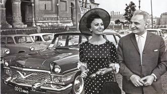 Actress Sophi Loren and Soviet actor Sergo Zakariadze by the Chaika car  GAZ-13. Moscow. 1965